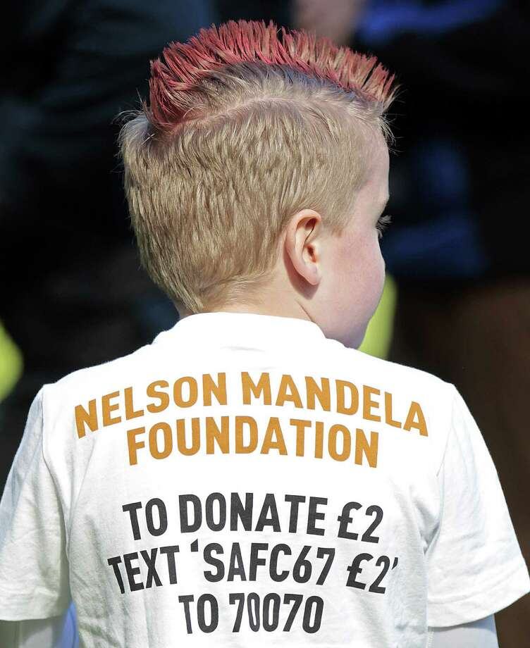 A mascot wears a t-shirt promoting Sunderland's collaboration with the Nelson Mandela Foundation before the English Premier League football match between Sunderland and Manchester United at the Stadium of Light in Sunderland, northeast England, on March 30, 2013. Manchester United won the game 1-0. AFP PHOTO/GRAHAM STUART Photo: GRAHAM STUART, AFP/Getty Images / AFP