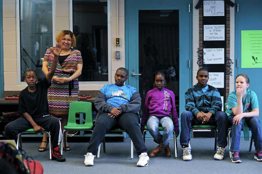 Melissa Fullmore, second from left,  the principal at Ruediger Elementary School, observes a fifth-grade music class at the school in Tallahassee, Fla., March 11, 2013. Across the country, education reformers and their allies in both parties have revamped the way teachers are graded, abandoning methods under which nearly everyone was deemed satisfactory, even when students were falling behind. (Sarah Beth Glicksteen/The New York Times) Photo: SARAH BETH GLICKSTEEN / NYTNS