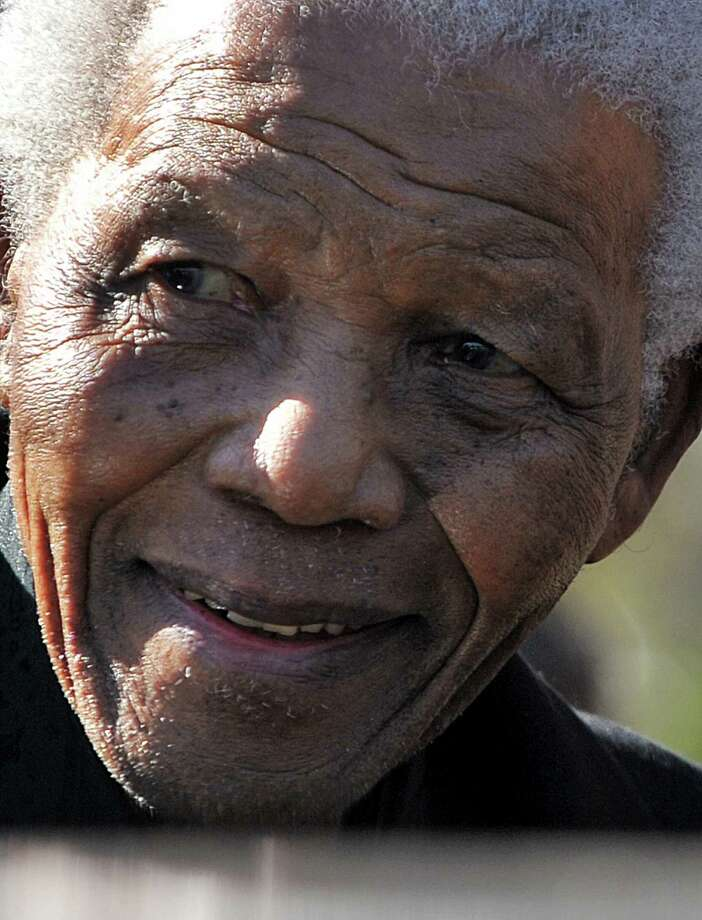 "A file picture taken on June 17, 2010 shows former South African President Nelson Mandela in Sandton. Nelson Mandela was in ""good spirits"" on March 29, 2013 as he spent a second day in hospital, in the latest health scare for the revered icon, South Africa's presidency said. AFP PHOTO / ALEXANDER JOE Photo: ALEXANDER JOE, AFP/Getty Images / AFP"