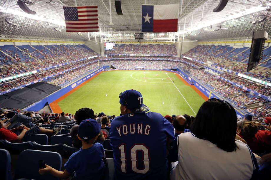 Among the Rangers fans at the Alamodome on Saturday to watch Texas play San Diego were the Ramirezes - Felix Michael II, 4, Felix Michael and JoAnn. Photo: Edward A. Ornelas, Staff / © 2013 San Antonio Express-News