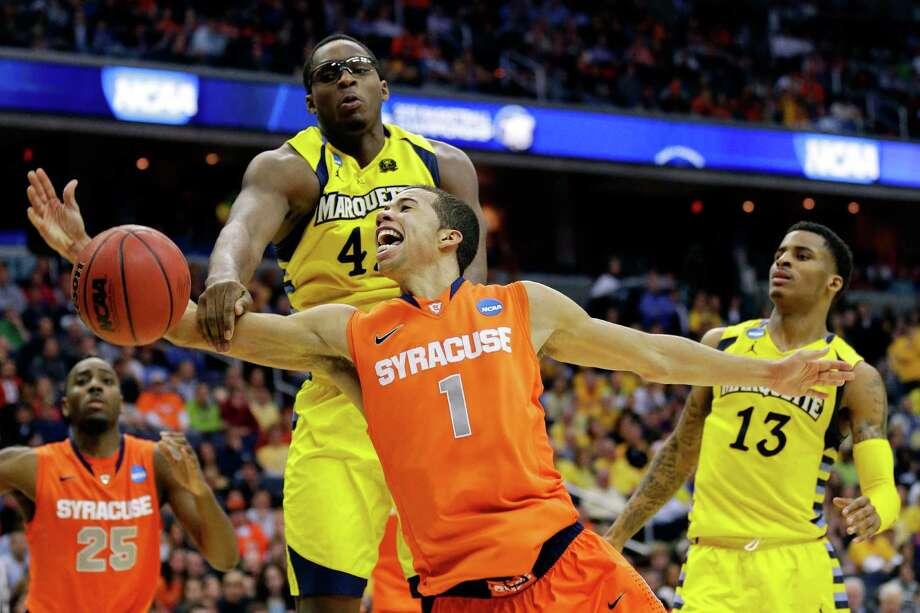 WASHINGTON, DC - MARCH 30:  Michael Carter-Williams #1 of the Syracuse Orange draws contact against Chris Otule #42 of the Marquette Golden Eagles during the East Regional Round Final of the 2013 NCAA Men's Basketball Tournament at Verizon Center on March 30, 2013 in Washington, DC. Photo: Rob Carr, Getty Images / 2013 Getty Images