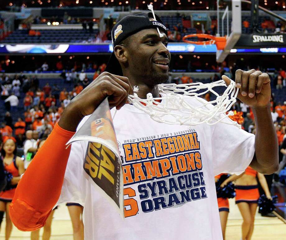 Syracuse 55, Marquette 39WASHINGTON, DC - MARCH 30:  Baye Keita #12 of the Syracuse Orange celebrates after defeating the Marquette Golden Eagles to win the East Regional Round Final of the 2013 NCAA Men's Basketball Tournament at Verizon Center on March 30, 2013 in Washington, DC. Photo: Rob Carr, Getty Images / 2013 Getty Images