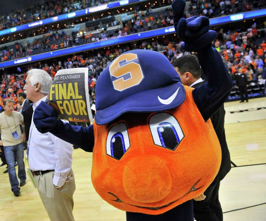 The Syracuse mascot celebrates following a 55-39 victory over Marquette in the NCAA Tournament East Regional final at the Verizon Center in Washington, D.C., Saturday, March 30, 2013. Syracuse is headed to the Final Four in Atlanta, Georgia. (Mark Gail/MCT) Photo: Mark Gail, McClatchy-Tribune News Service / MCT