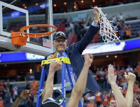 Syracuse head coach Jim Boeheim holds up the net to players, after Syracuse defeated Marquette 55-39 in the NCAA Tournament East Regional final at the Verizon Center in Washington, D.C., Saturday, March 30, 2013. Syracuse is headed to the Final Four in Atlanta, Georgia. (Harry E. Walker/MCT) Photo: Harry E. Walker, McClatchy-Tribune News Service / Harry E. Walker, Copyright 2012