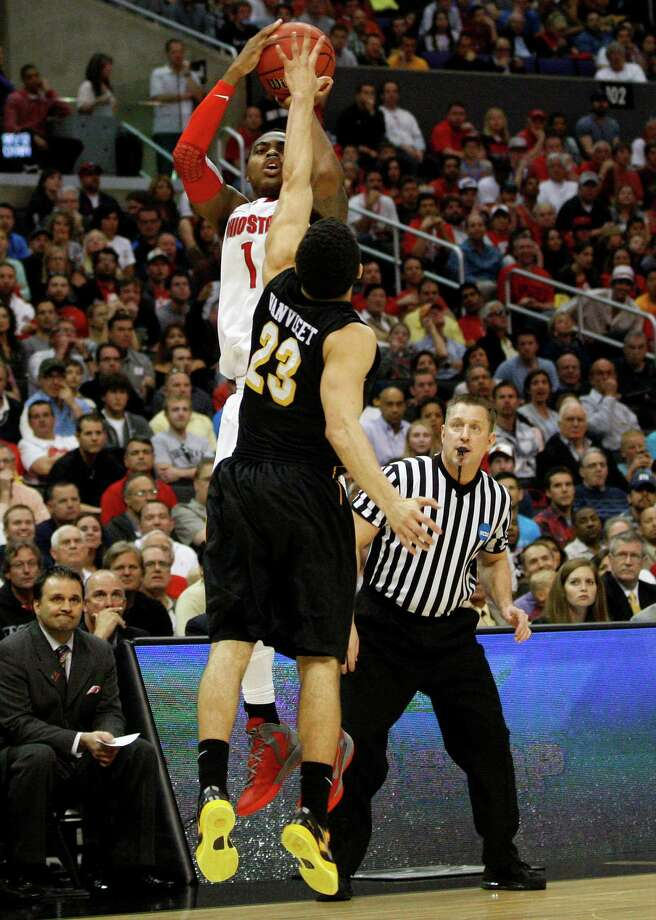Ohio State's Deshaun Thomas (1) can't make a 3-pointer against Wichita State's Fred Van Vleet (23) in the first half of the West Region Final of the NCAA Tournament on Saturday, March 29, 2013, at Staples Center in Los Angeles, California. (Kyle Robertson/Columbus Dispatch/MCT) Photo: Kyle Robertson, McClatchy-Tribune News Service / Columbus Dispatch