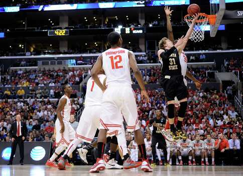 LOS ANGELES, CA - MARCH 30:  Ron Baker #31 of the Wichita State Shockers goes up for a shot against Evan Ravenel #30 of the Ohio State Buckeyes in the first half during the West Regional Final of the 2013 NCAA Men's Basketball Tournament at Staples Center on March 30, 2013 in Los Angeles, California. Photo: Harry How, Getty Images / 2013 Getty Images