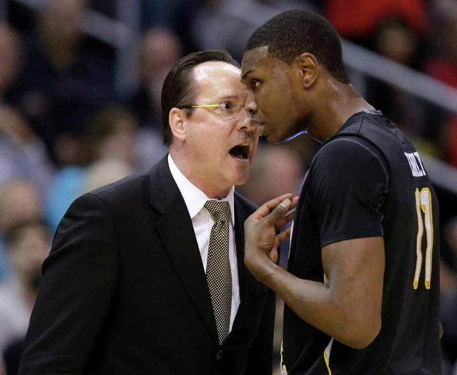 Wichita State coach Gregg Marshall talks to Cleanthony Early during the first half of the West Regional final against Ohio State in the NCAA men's college basketball tournament, Saturday, March 30, 2013, in Los Angeles. (AP Photo/Jae C. Hong) Photo: Jae C. Hong, Associated Press / AP