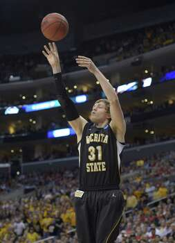 Wichita State guard Ron Baker (31) makes a shot against Ohio State during the first half of a West Regional final in the NCAA college basketball tournament, Saturday, March 30, 2013, in Los Angeles. (AP Photo/Mark J. Terrill) Photo: Mark J. Terrill, Associated Press / AP