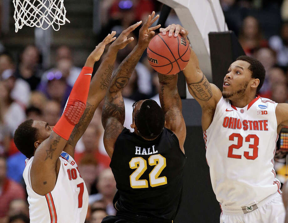 Wichita State forward Carl Hall (22) has a shot rejected by Ohio State center Amir Williams (23) as Ohio State forward Deshaun Thomas helps on defends during the first half of the West Regional final in the NCAA men's college basketball tournament, Saturday, March 30, 2013, in Los Angeles. (AP Photo/Jae C. Hong) Photo: Jae C. Hong, Associated Press / AP