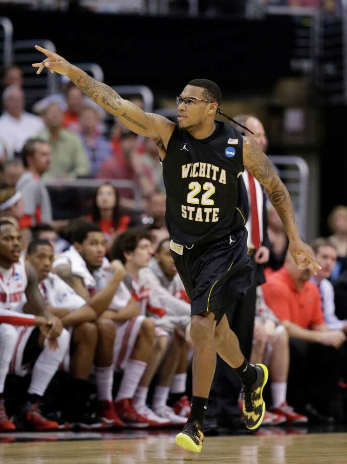 Wichita State forward Carl Hall celebrates a field goal against Ohio State during the first half of the West Regional final in the NCAA men's college basketball tournament, Saturday, March 30, 2013, in Los Angeles. (AP Photo/Jae C. Hong) Photo: Jae C. Hong, Associated Press / AP