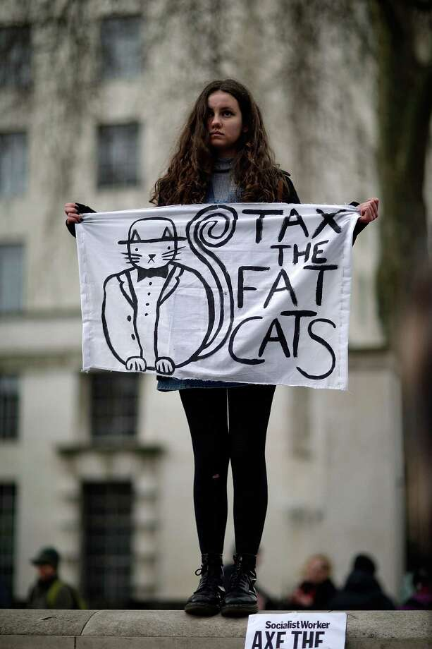 "A protestor holds a sign with a drawing while demonstrating against the proposed ""bedroom tax"" gather in Trafalgar Square before marching to Downing Street on March 30, 2013 in London, England. Photo: Matthew Lloyd, Getty Images / 2013 Getty Images"