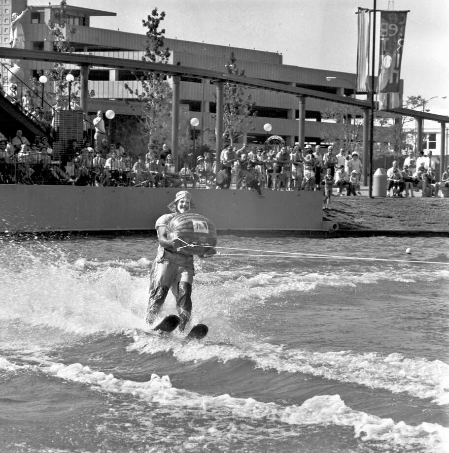 A water-skiing clown holds a watermelon during a show on the lagoon at HemisFair '68. Photo: San Antonio Express-News File Photo / UTSA'S INSTITUTE OF TEXAN CULTUR