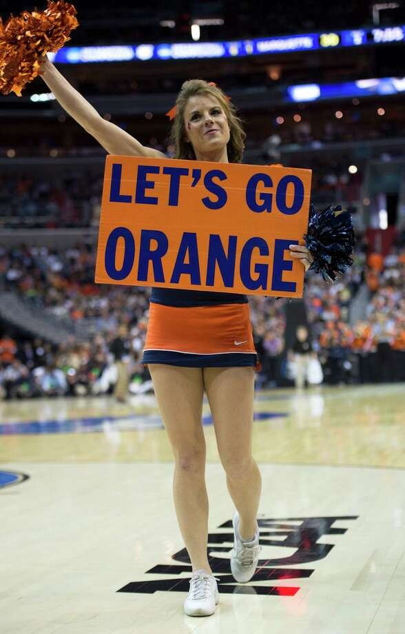Road to Atlanta: Look back at the full March Badness bracketLive Updates: Follow all the Final Four actionA Syracuse cheerleader roots on her team in the second half of the NCAA Tournament East Regional final against Marquette at the Verizon Center in Washington, D.C., Saturday, March 30, 2013. Syracuse defeated Marquette, 55-39, and is headed to the Final Four in Atlanta, Georgia. Photo: Harry E. Walker, McClatchy-Tribune News Service / Harry E. Walker, Copyright 2012