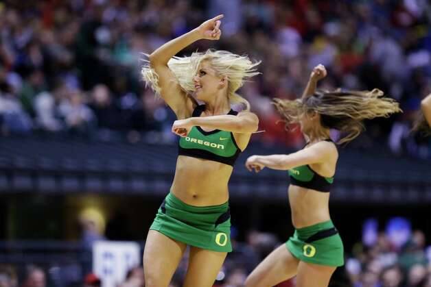 Oregon cheerleaders perform during the second half of a regional semifinal against Louisville in the NCAA college basketball tournament, Friday, March 29, 2013, in Indianapolis. Louiville won 77-69. (AP Photo/Michael Conroy) Photo: Michael Conroy, Associated Press / AP