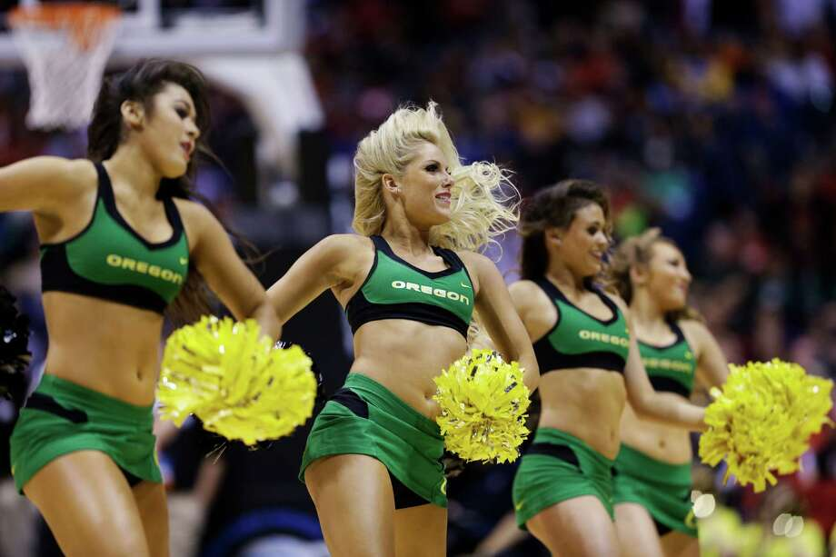 Oregon cheerleaders perform during the first half of a regional semifinal against Louisville in the NCAA college basketball tournament, Friday, March 29, 2013, in Indianapolis. (AP Photo/Darron Cummings) Photo: Darron Cummings, Associated Press / AP