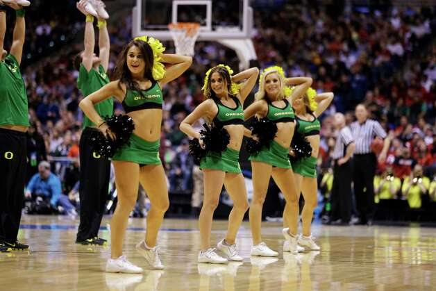 Oregon cheerleaders perform during the second half of a regional semifinal against Louisville in the NCAA college basketball tournament, Friday, March 29, 2013, in Indianapolis. (AP Photo/Darron Cummings) Photo: Darron Cummings, Associated Press / AP