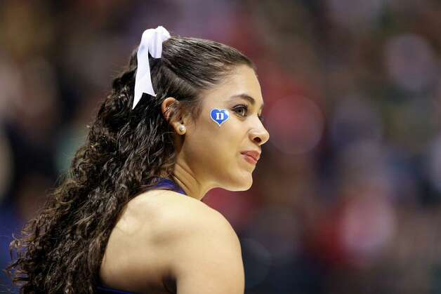 INDIANAPOLIS, IN - MARCH 29:  A cheerleader for the Duke Blue Devils looks on against the Michigan State Spartans during the Midwest Region Semifinal round of the 2013 NCAA Men's Basketball Tournament at Lucas Oil Stadium on March 29, 2013 in Indianapolis, Indiana. Photo: Andy Lyons, Getty Images / 2013 Getty Images