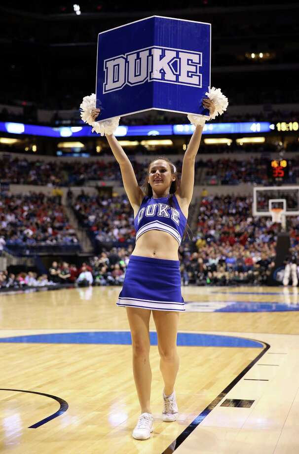 INDIANAPOLIS, IN - MARCH 29:  A cheerleader for the Duke Blue Devils performs in the second half against the Michigan State Spartans during the Midwest Region Semifinal round of the 2013 NCAA Men's Basketball Tournament at Lucas Oil Stadium on March 29, 2013 in Indianapolis, Indiana. Photo: Andy Lyons, Getty Images / 2013 Getty Images