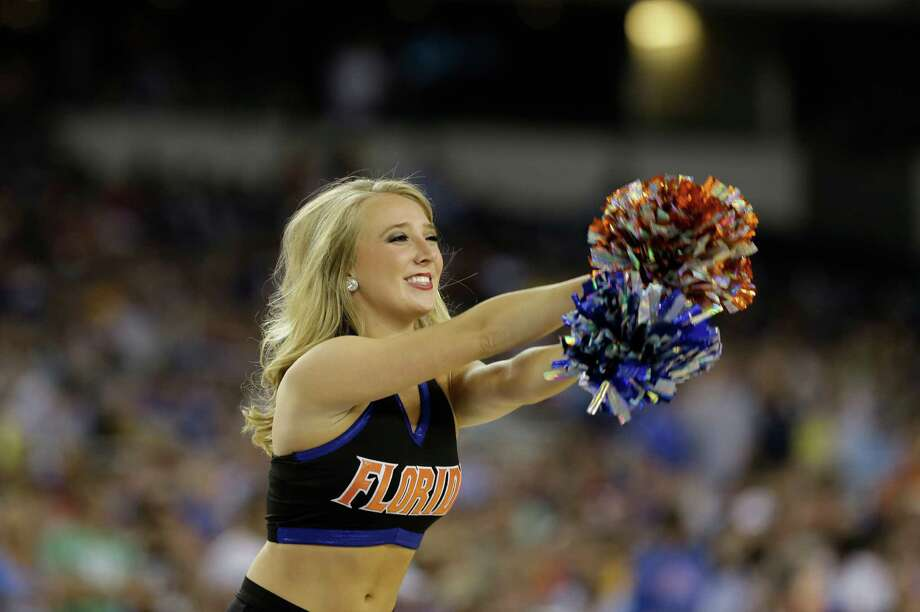 A Florida cheerleader performs during the first half of a regional semifinal game against Florida Gulf Coast in the NCAA college basketball tournament, Friday, March 29, 2013, in Arlington, Texas. (AP Photo/Tony Gutierrez) Photo: Tony Gutierrez, Associated Press / AP