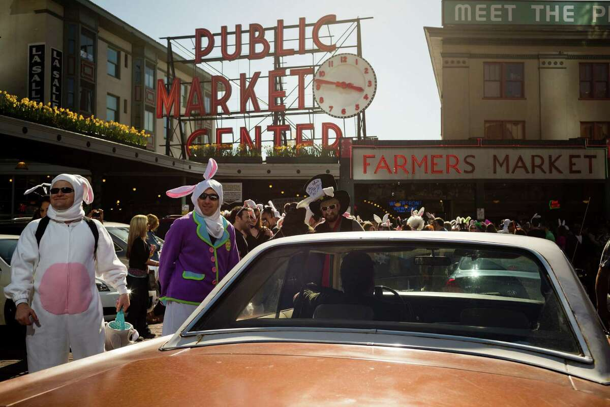 Colorful masses of rabbit-eared attendees pack the Pike Place Market.
