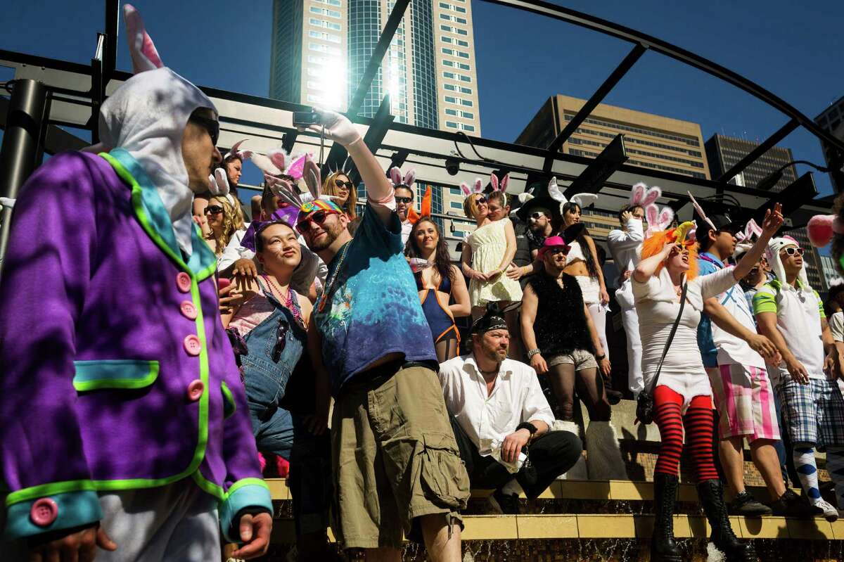 Colorful masses of rabbit-eared attendees mob the Harbor Steps and other areas of downtown Seattle during the annual BunnyCon Bunny Bar Hop on Saturday, March 30, 2013, the day before Easter Sunday. Groups flocked from bar to bar for the all-day pub crawl and pseudo flashmob.