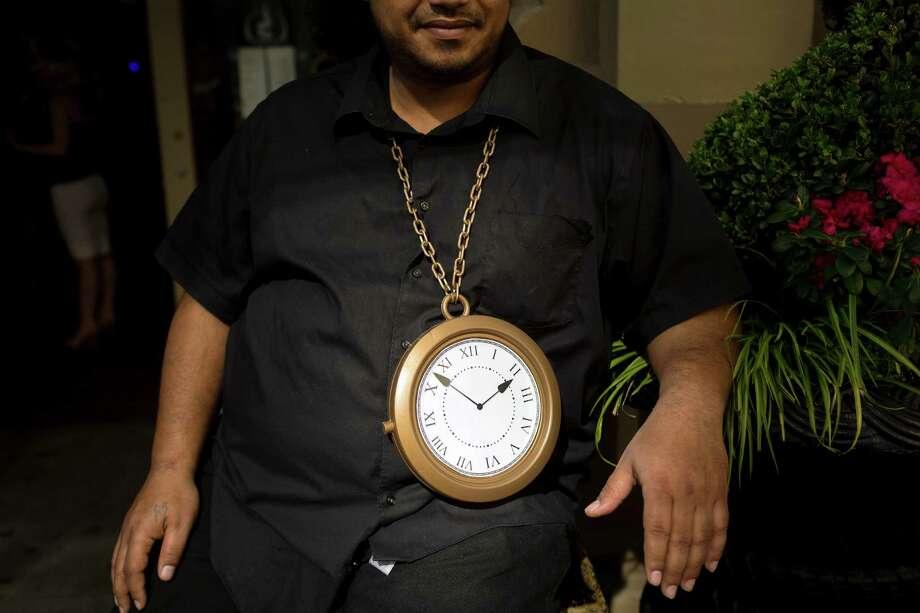 Fado's doorman sports a clock necklace. Photo: JORDAN STEAD / SEATTLEPI.COM