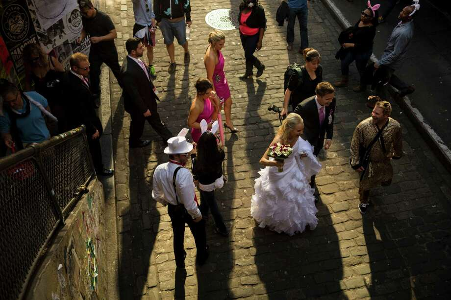 A just-married couple navigates a colorful mass of rabbit-eared attendees. Photo: JORDAN STEAD / SEATTLEPI.COM