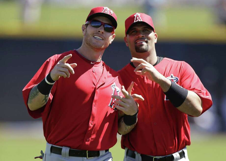 Angels left fielder Josh Hamilton (left) and first baseman Albert Pujols, joking around before a spring training game, should have Los Angeles in contention. Photo: Gregory Bull / Associated Press