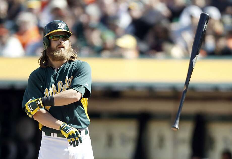 A's Josh Reddick, (16) draws a walk in the eighth inning as the Oakland Athletics went on to beat the San Francisco Giants 4-3 at the O.co Coliseum in Oakland, Ca. on Saturday Mar. 30, 2013. Photo: Michael Macor, The Chronicle