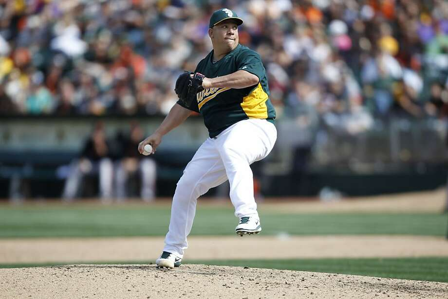 A's pitcher Bartolo Colon, (40) pitches in the eighth inning  as the Oakland Athletics went on to beat the San Francisco Giants 4-3 at the O.co Coliseum in Oakland, Ca. on Saturday Mar. 30, 2013. Photo: Michael Macor, The Chronicle