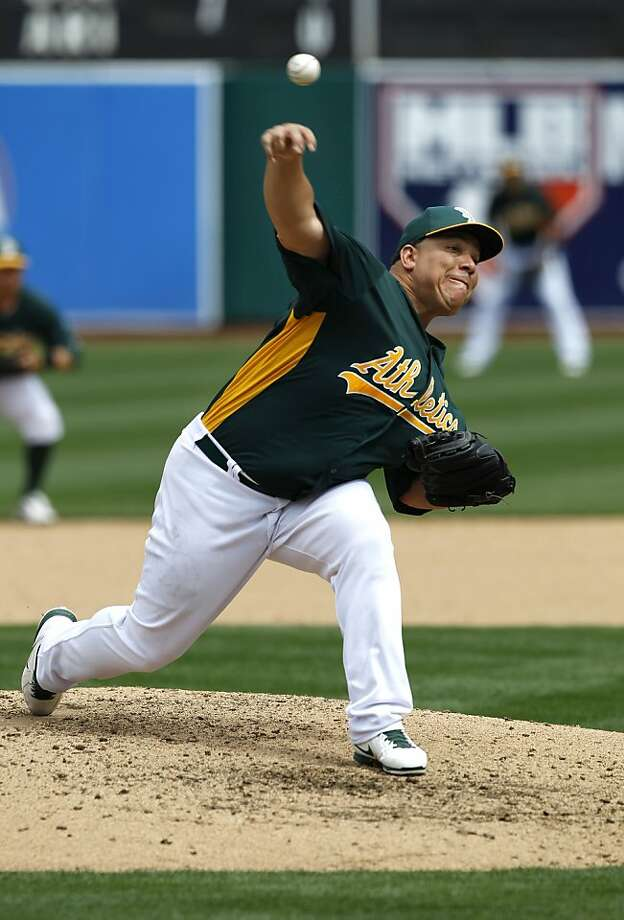 A's pitcher, Bartolo Colon,(40) threw the last three innings, as the Oakland Athletics went on to beat the San Francisco Giants 4-3 at the O.co Coliseum in Oakland, Ca. on Saturday Mar. 30, 2013. Photo: Michael Macor, The Chronicle