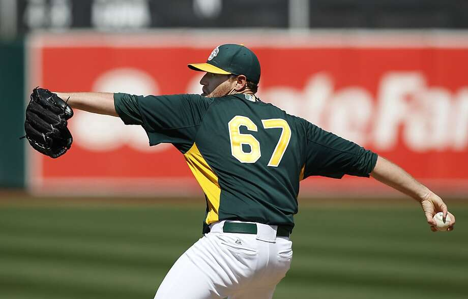 The A's starting pitcher Dan Strailey, (67) throws in the third inning, as the Oakland Athletics went on to beat the San Francisco Giants 4-3 at the O.co Coliseum in Oakland, Ca. on Saturday Mar. 30, 2013. Photo: Michael Macor, The Chronicle