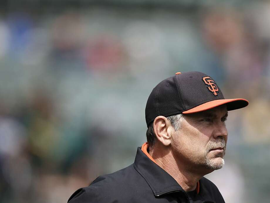 Giants manager, Bruce Bochy watches batting practice before the start of the game, as the San Francisco Giants prepare to take on the Oakland Athletics at the O.co Coliseum in Oakland, Ca. on Saturday Mar. 30, 2013. Photo: Michael Macor, The Chronicle