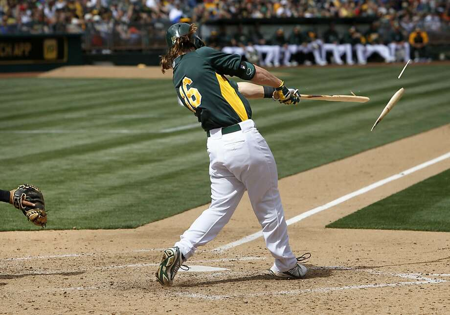 The A's Josh Reddick, (16) hits a broken bat single in the fifth inning, as the Oakland Athletics went on to beat the San Francisco Giants 4-3 at the O.co Coliseum in Oakland, Ca. on Saturday Mar. 30, 2013. Photo: Michael Macor, The Chronicle