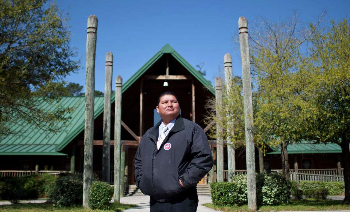 Kyle Williams, chairman of the Alabama-Coushatta Tribe, stands in front of what was a gaming casino that turned $1 million a month profit for nine months until it was shut in a decision by a federal court.