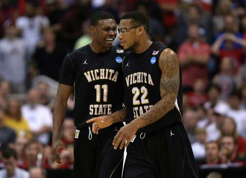LOS ANGELES, CA - MARCH 30:  Cleanthony Early #11 and Carl Hall #22 of the Wichita State Shockers talk in the second half while taking on the Ohio State Buckeyes during the West Regional Final of the 2013 NCAA Men's Basketball Tournament at Staples Center on March 30, 2013 in Los Angeles, California. Photo: Jeff Gross, Getty Images / 2013 Getty Images