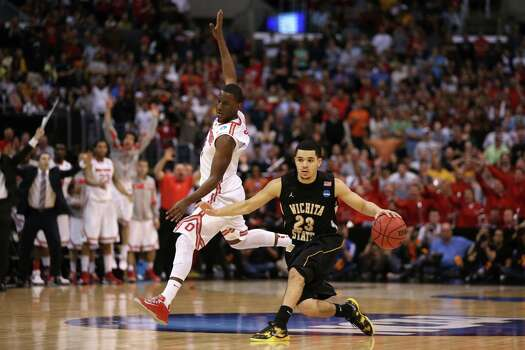 LOS ANGELES, CA - MARCH 30:  Fred Van Vleet #23 of the Wichita State Shockers moves the ball against Shannon Scott #3 of the Ohio State Buckeyes in the second half during the West Regional Final of the 2013 NCAA Men's Basketball Tournament at Staples Center on March 30, 2013 in Los Angeles, California. Photo: Jeff Gross, Getty Images / 2013 Getty Images