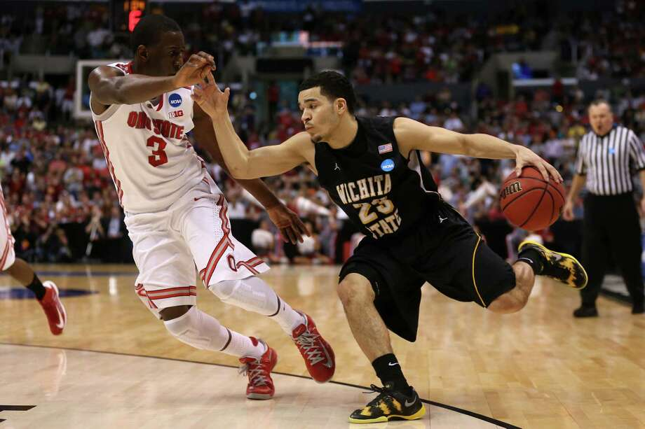 LOS ANGELES, CA - MARCH 30:  Fred Van Vleet #23 of the Wichita State Shockers drives against Shannon Scott #3 of the Ohio State Buckeyes in the second half during the West Regional Final of the 2013 NCAA Men's Basketball Tournament at Staples Center on March 30, 2013 in Los Angeles, California. Photo: Jeff Gross, Getty Images / 2013 Getty Images