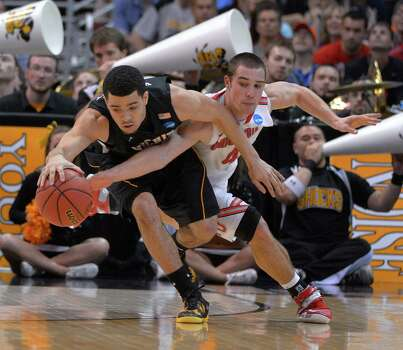 Wichita State's Fred Van Vleet, left, and Ohio State guard Aaron Craft chase a loose ball during the second half of the West Regional final in the NCAA men's college basketball tournament, Saturday, March 30, 2013, in Los Angeles. (AP Photo/Mark J. Terrill) Photo: Mark J. Terrill, Associated Press / AP