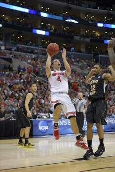 Ohio State guard Aaron Craft (4) shoots over Wichita State guard Tekele Cotton (32) during the second half of a West Regional final in the NCAA college basketball tournament, Saturday, March 30, 2013, in Los Angeles. (AP Photo/Mark J. Terrill) Photo: Mark J. Terrill, Associated Press / AP