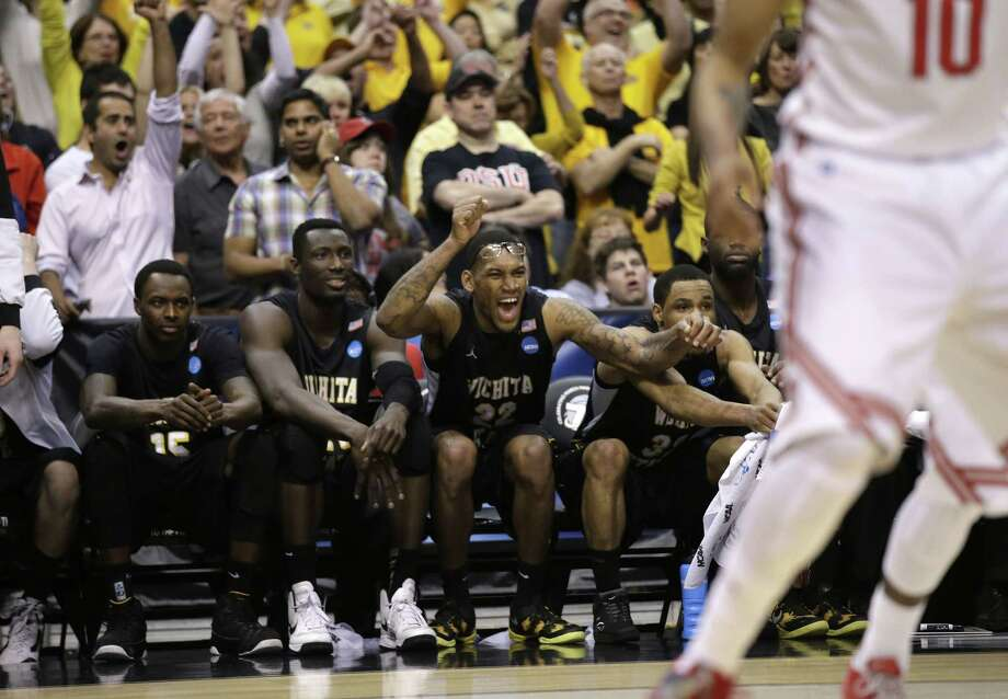 Wichita State players react from the bench during the second half against Ohio State in the West Regional final in the NCAA men's college basketball tournament, Saturday, March 30, 2013, in Los Angeles. (AP Photo/Jae C. Hong) Photo: Jae C. Hong, Associated Press / AP