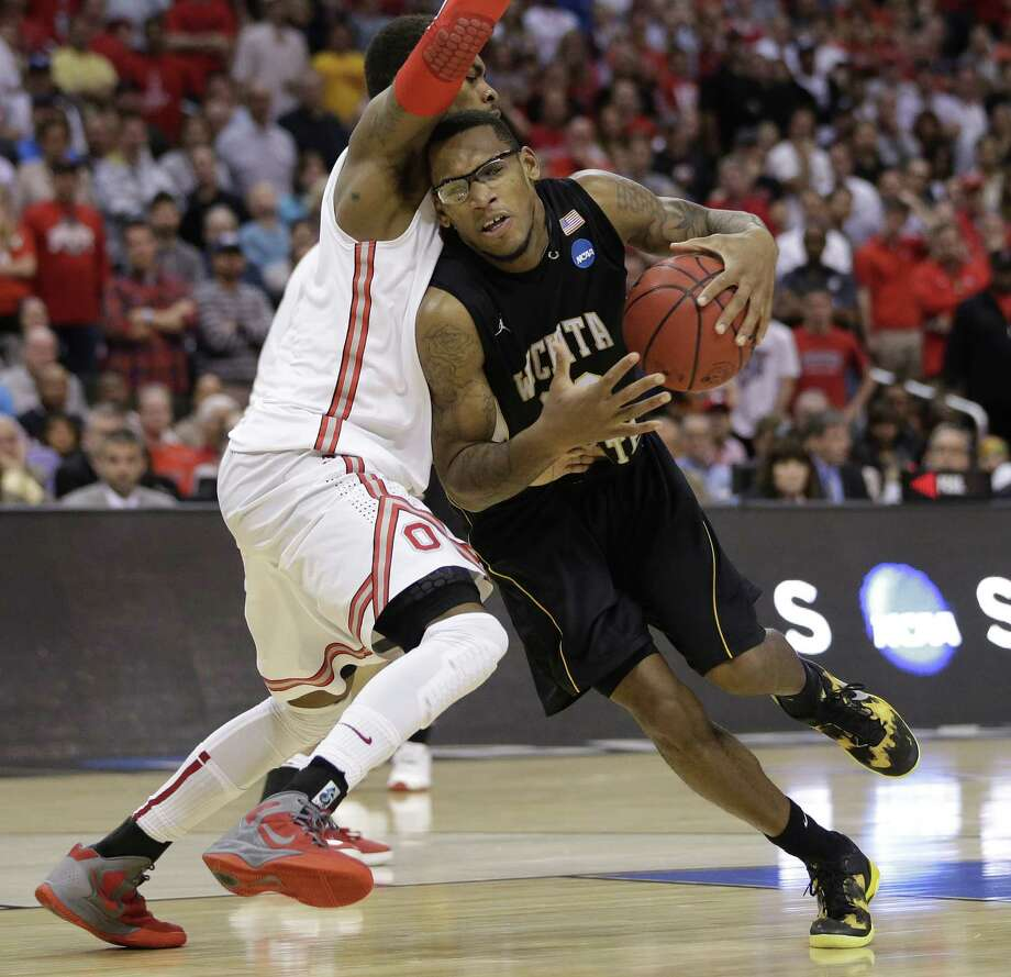 Ohio State forward Deshaun Thomas, left, defends against Wichita State forward Carl Hall during the second half of the West Regional final in the NCAA men's college basketball tournament, Saturday, March 30, 2013, in Los Angeles. (AP Photo/Jae C. Hong) Photo: Jae C. Hong, Associated Press / AP