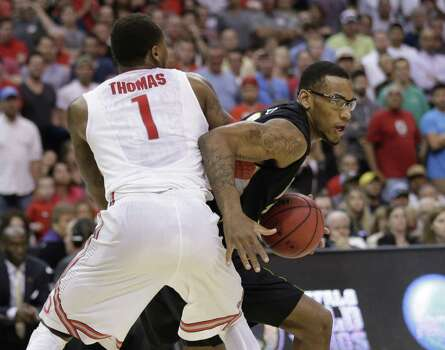Ohio State forward Deshaun Thomas (1) and Wichita State forward Carl Hall mix it up during the second half of a West Regional final in the NCAA college basketball tournament, Saturday, March 30, 2013, in Los Angeles. (AP Photo/Jae C. Hong) Photo: Jae C. Hong, Associated Press / AP