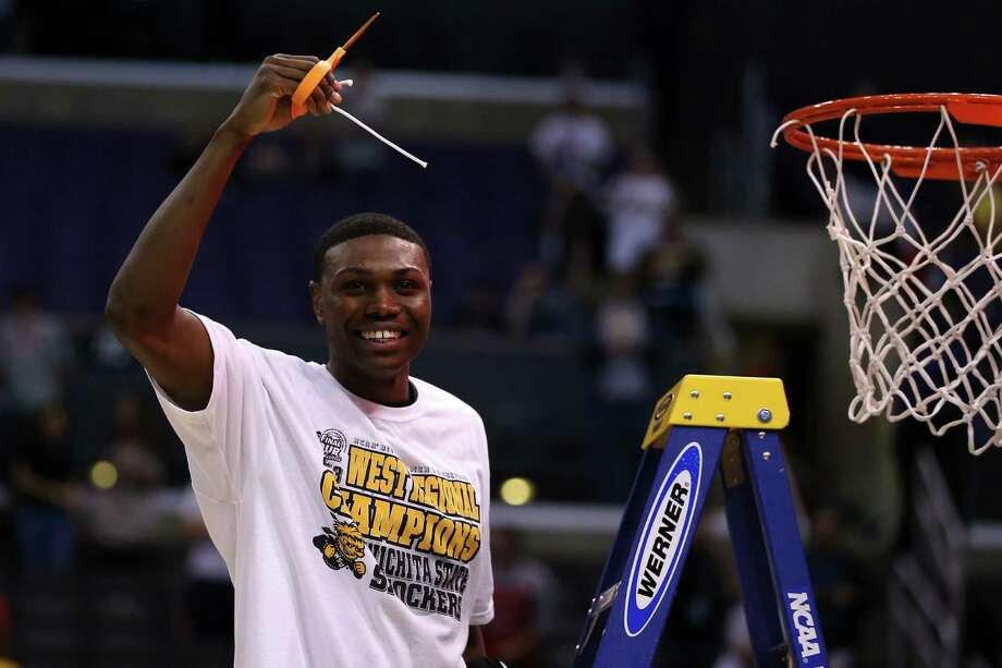 LOS ANGELES, CA - MARCH 30:  Cleanthony Early #11 of the Wichita State Shockers celebrates by cutting down the net after defeating the Ohio State Buckeyes 70-66 during the West Regional Final of the 2013 NCAA Men's Basketball Tournament at Staples Center on March 30, 2013 in Los Angeles, California. Photo: Jeff Gross, Getty Images / 2013 Getty Images