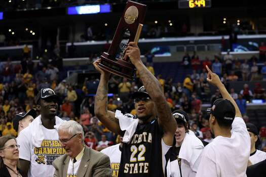 LOS ANGELES, CA - MARCH 30:  Carl Hall #22 of the Wichita State Shockers holds up the West Regional Trophy after defeating the Ohio State Buckeyes 70-66 during the West Regional Final of the 2013 NCAA Men's Basketball Tournament at Staples Center on March 30, 2013 in Los Angeles, California. Photo: Jeff Gross, Getty Images / 2013 Getty Images