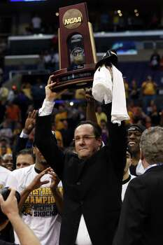 LOS ANGELES, CA - MARCH 30:  Head coach Gregg Marshall of the Wichita State Shockers holds up the West Regional Trophy after defeating the Ohio State Buckeyes 70-66 during the West Regional Final of the 2013 NCAA Men's Basketball Tournament at Staples Center on March 30, 2013 in Los Angeles, California. Photo: Jeff Gross, Getty Images / 2013 Getty Images