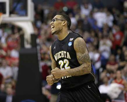 Wichita State forward Carl Hall celebrates his team's 70-66 win over Ohio State in the West Regional final in the NCAA men's college basketball tournament, Saturday, March 30, 2013, in Los Angeles. (AP Photo/Jae C. Hong) Photo: Jae C. Hong, Associated Press / AP