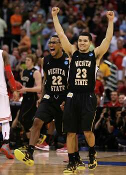 LOS ANGELES, CA - MARCH 30:  Fred Van Vleet #23 and Carl Hall #22 of the Wichita State Shockers celebrate after defeating the Ohio State Buckeyes 70-66 during the West Regional Final of the 2013 NCAA Men's Basketball Tournament at Staples Center on March 30, 2013 in Los Angeles, California. Photo: Jeff Gross, Getty Images / 2013 Getty Images