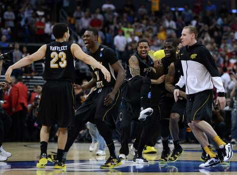 LOS ANGELES, CA - MARCH 30:  Fred Van Vleet #23 and Cleanthony Early #11 of the Wichita State Shockers celebrate after defeating the Ohio State Buckeyes 70-66 during the West Regional Final of the 2013 NCAA Men's Basketball Tournament at Staples Center on March 30, 2013 in Los Angeles, California. Photo: Harry How, Getty Images / 2013 Getty Images