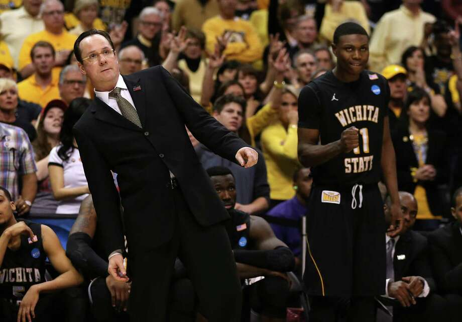 LOS ANGELES, CA - MARCH 30:  Head coach Gregg Marshall and Cleanthony Early #11 of the Wichita State Shockers react from the bench late in the second half against the Ohio State Buckeyes during the West Regional Final of the 2013 NCAA Men's Basketball Tournament at Staples Center on March 30, 2013 in Los Angeles, California. Photo: Jeff Gross, Getty Images / 2013 Getty Images